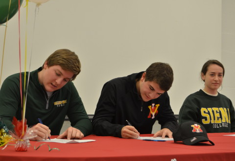 The signees sign their rights away!