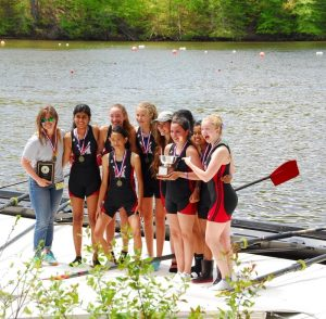 A Boat Length- The Women's third eight, with coach Danielle Holstrom, receive their gold medals on the medals dock.The 3v won their category by . ... seconds over the second place Yorktown crew. (Image obtained via?)