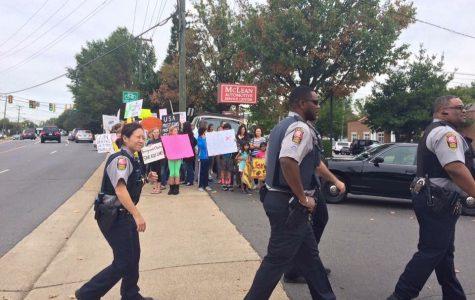 Gun store draws protests