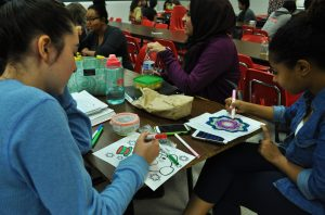 "Art is a great way to relieve stress, as these students know, coloring pictures provided by the Active Minds Club for ""Laugh More, Stress Less"" week."