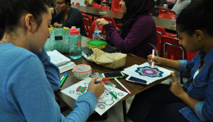 """Art is a great way to relieve stress, as these students know, coloring pictures provided by the Active Minds Club for """"Laugh More, Stress Less"""" week."""