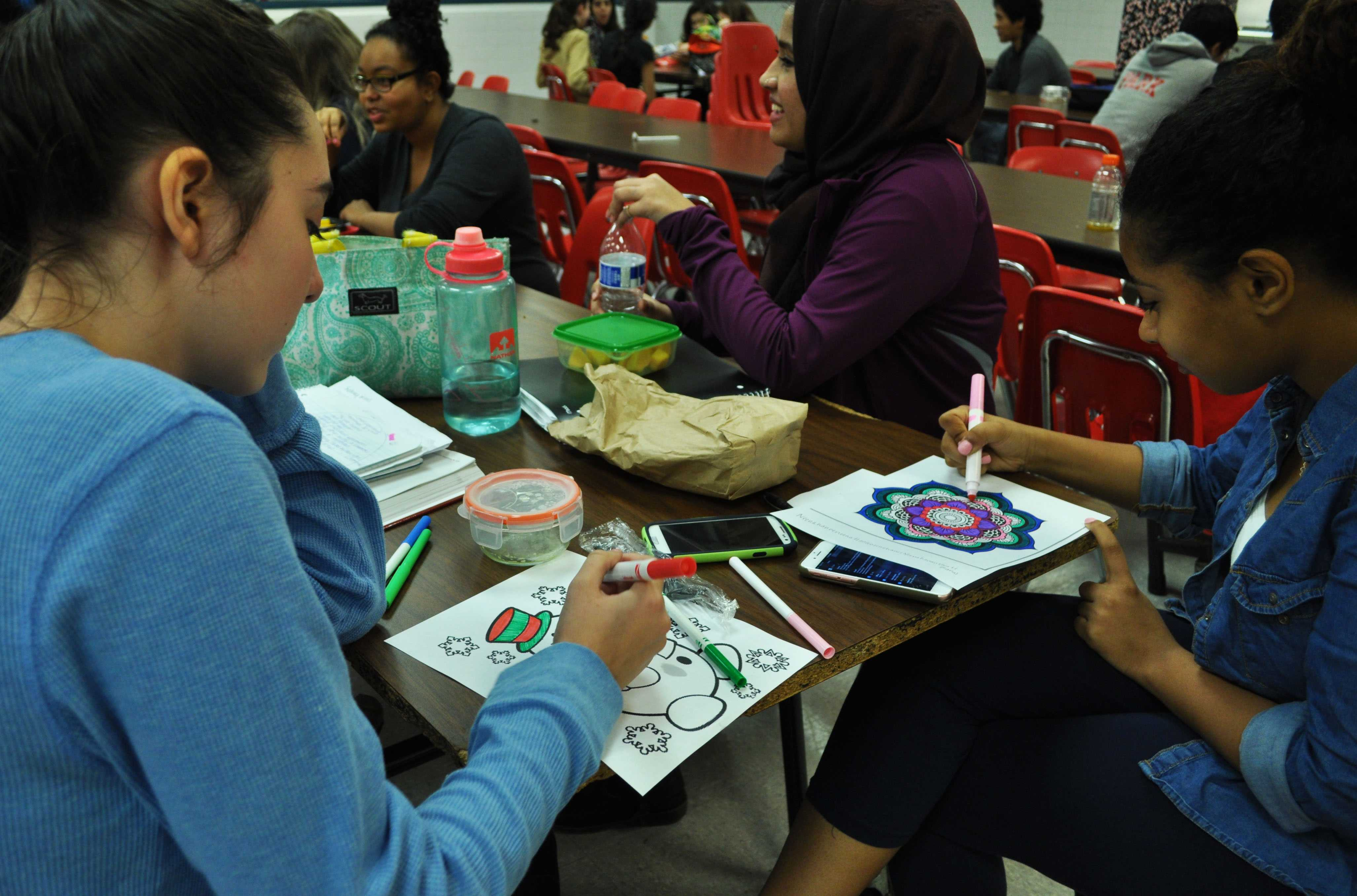 Art is a great way to relieve stress, as these students know, coloring pictures provided by the Active Minds Club for