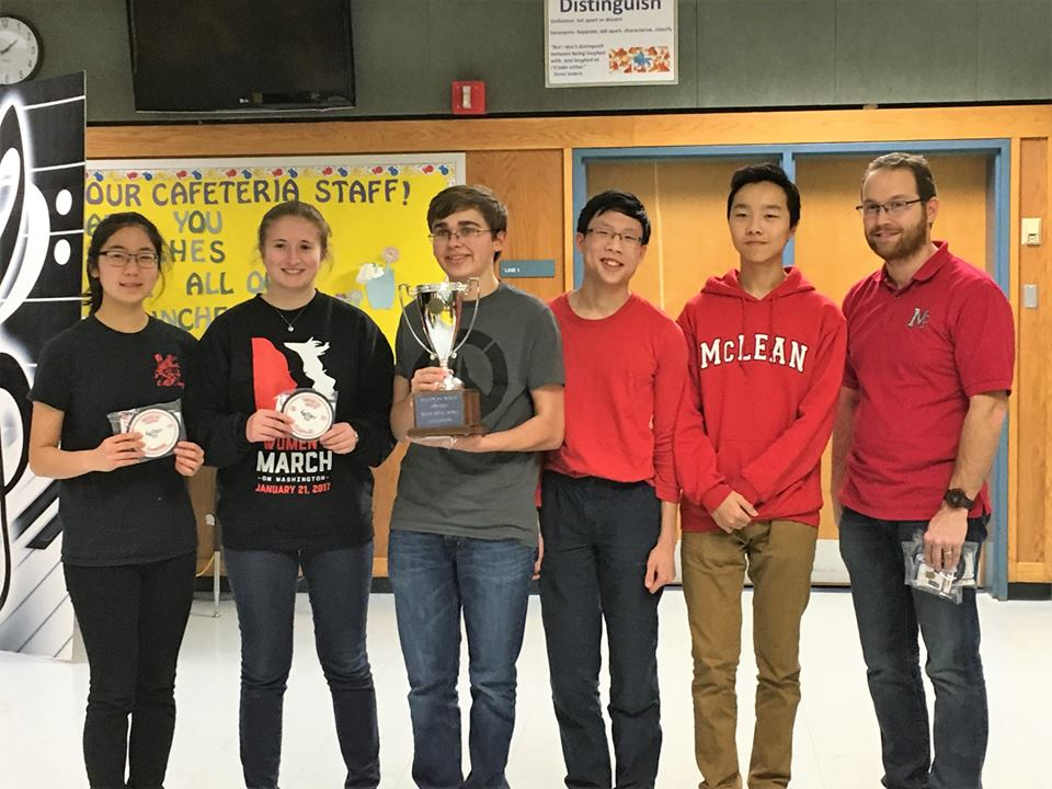 The McLean Scholastic Bowl team is pictured here, after winning the Region 6A North tournament. From left to right, the team consists of Grace Chung (10), Mara Kessler (10), Carson Flickinger (11), Justin Young (9), Ethan Li (9), and team coach/physics teacher Jeff Brocketti. (Photo courtesy of Margaret Flickinger)