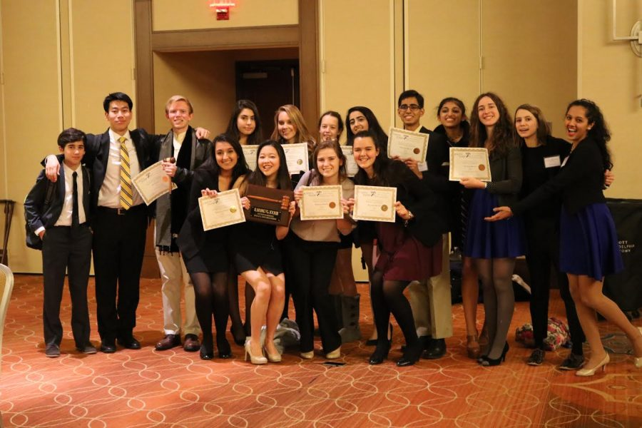 The+16+delegates+who+represented+McLean+MUN+at+the+Ivy+League+Model+United+Nations+Conference+pose+after+the+awards+ceremony.+%28Photo+courtesy+of+McLean+MUN%29
