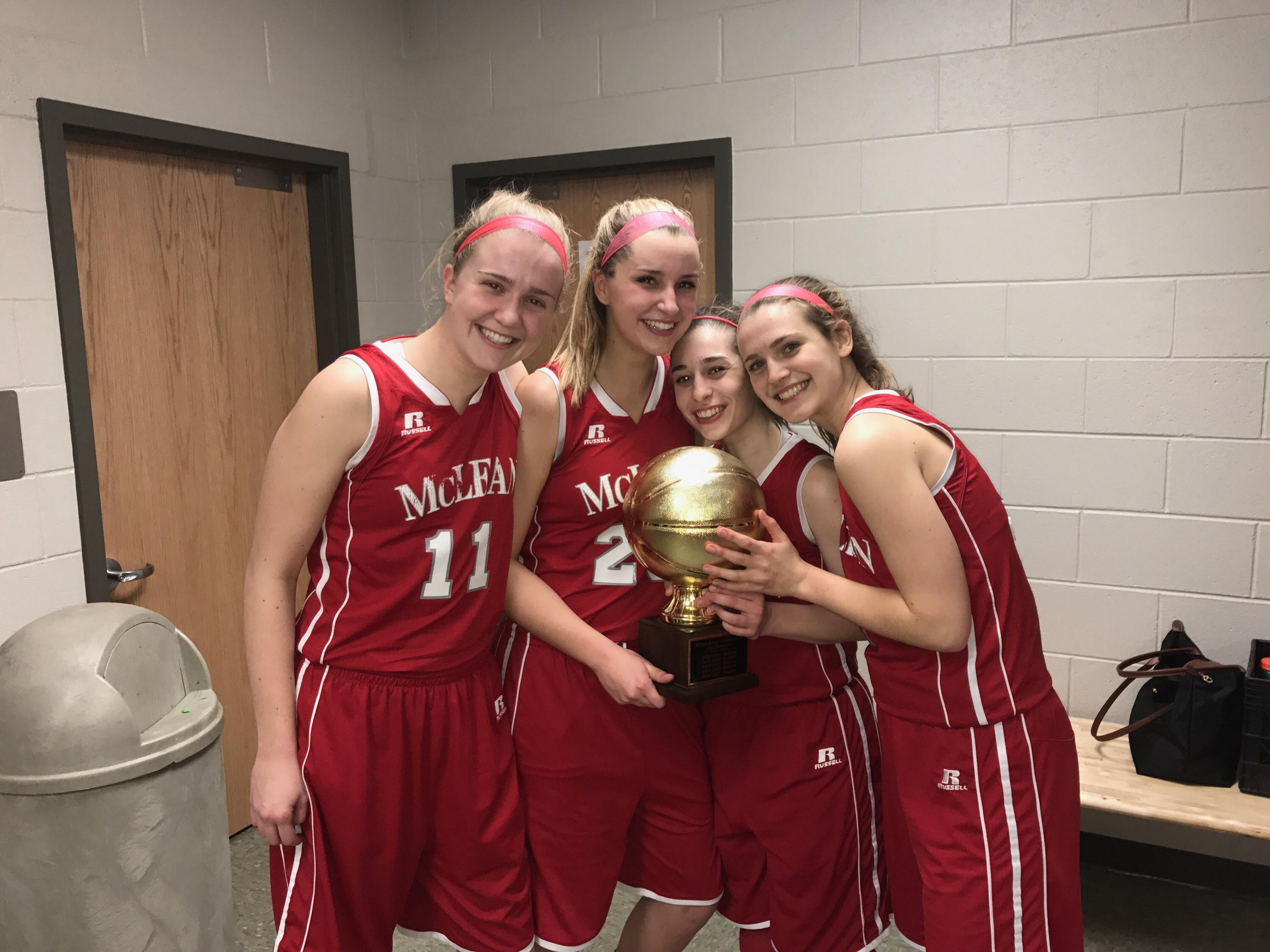 Senior captains Caroline Lewis, Hannah Smith, Vanessa Barlow, and Anna Murphy pose after victory against Langley. (Photo courtesy of Caroline Lewis)