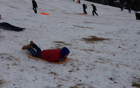 Students sled during snow days