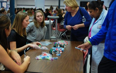 Students exchange paper gifts for prizes during Laugh More Stress Less Week