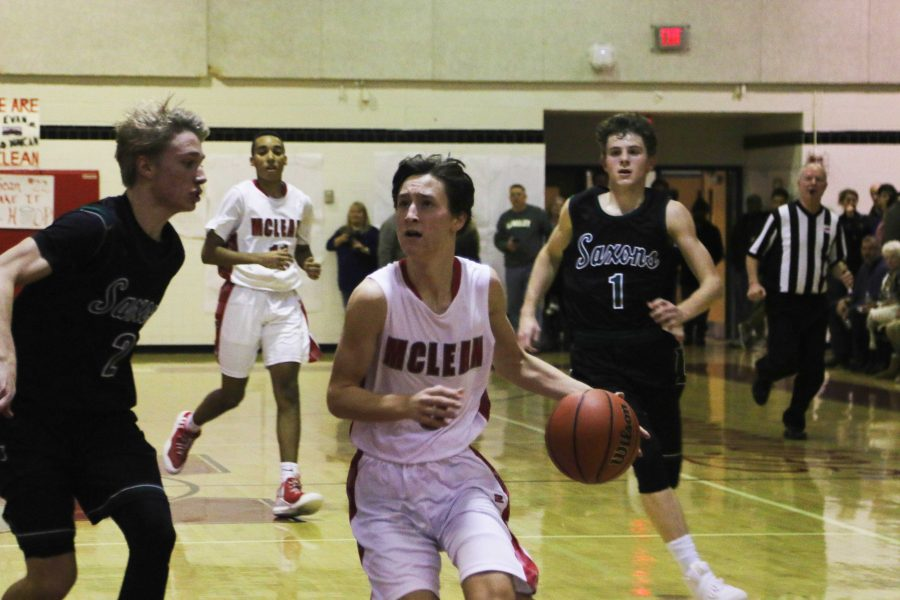 Sophomore+Tucker+Leggett+drives+deep+into+the+Langley+defense+as+the+McLean+boys+try+to+claw+their+way+back+into+a+tight+game.+McLean+went+on+to+loose+46-60.+%28Photo+by+Imani+McCormick%29