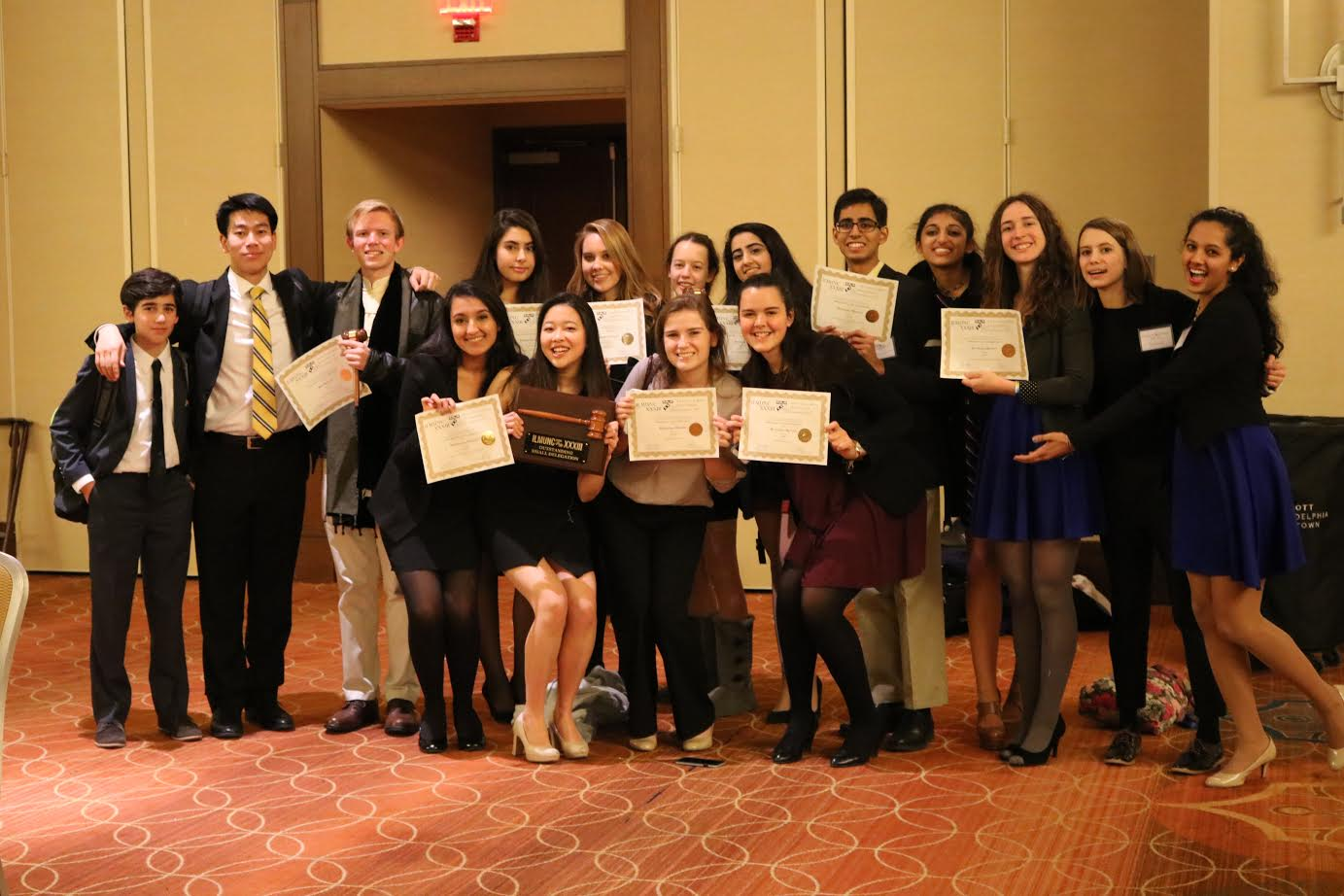 The 16 delegates who represented McLean MUN at the Ivy League Model United Nations Conference pose after the awards ceremony. (Photo courtesy of McLean MUN)