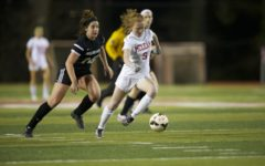 Junior Cayla Davis storms upfield late in the game.