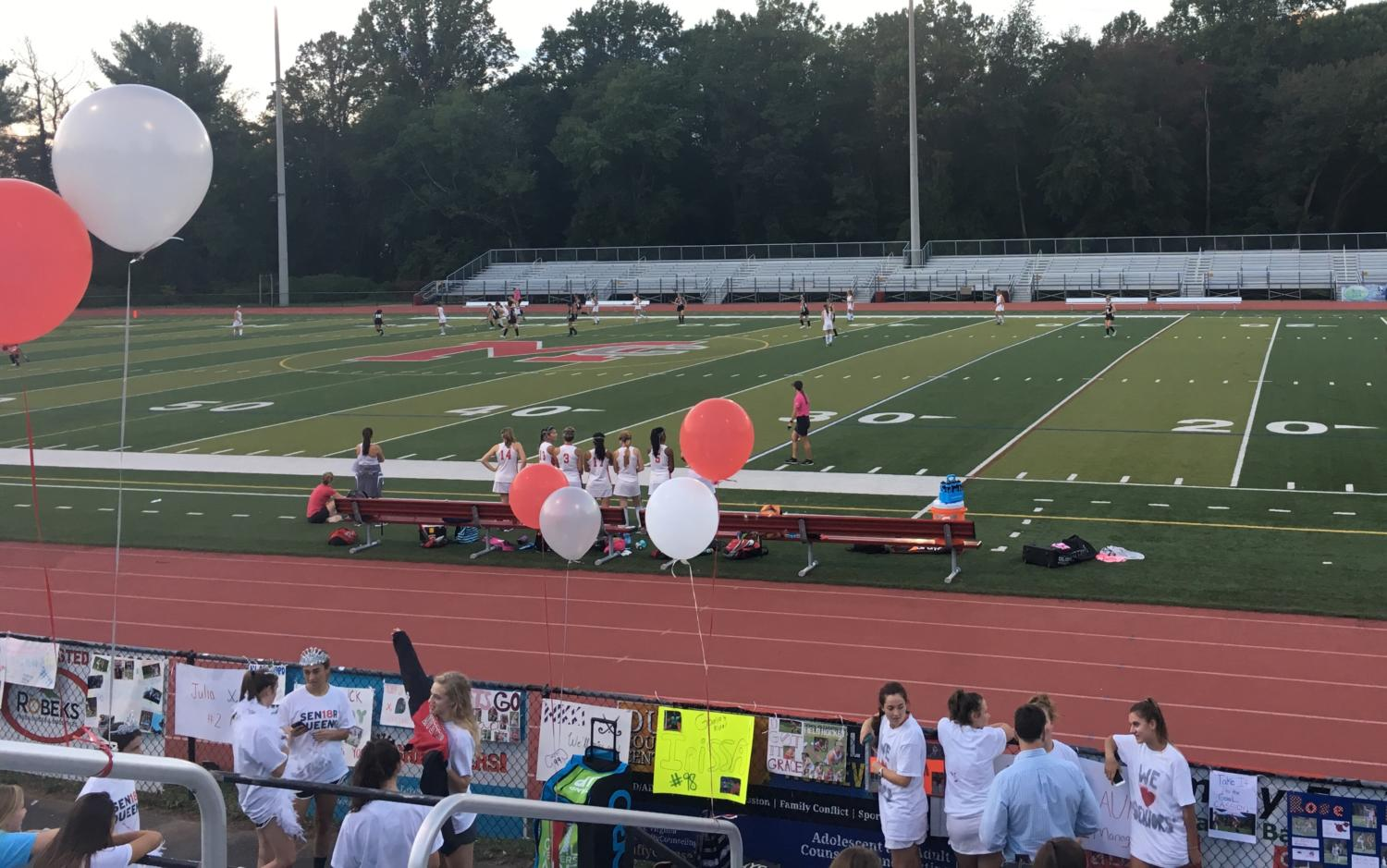 McLean field hockey celebrates a great season with red and white balloons on Senior Night on Oct. 10. (Photo by Emily Jackson)