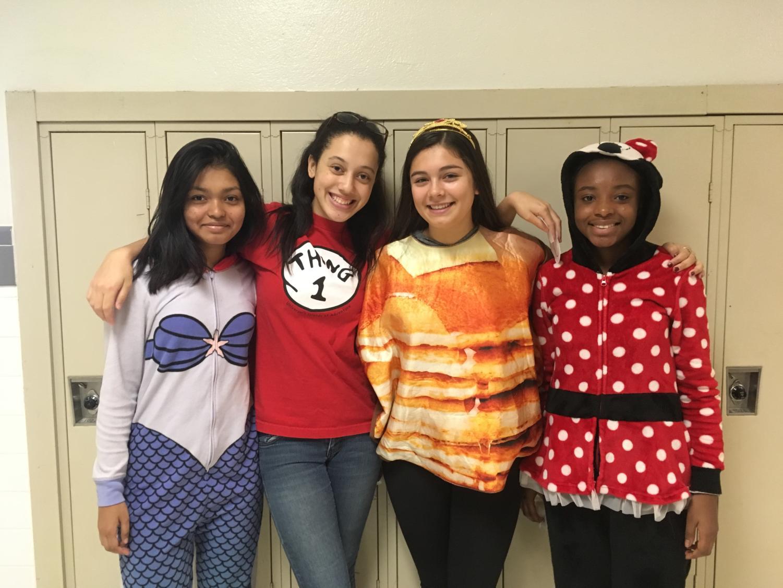 From left to right Junior Fatama Hossain, Senior Mikaley Bolden, Senior Havi Carrillo-Klein, and Junior Tryphena Koomson show their Halloween spirit.