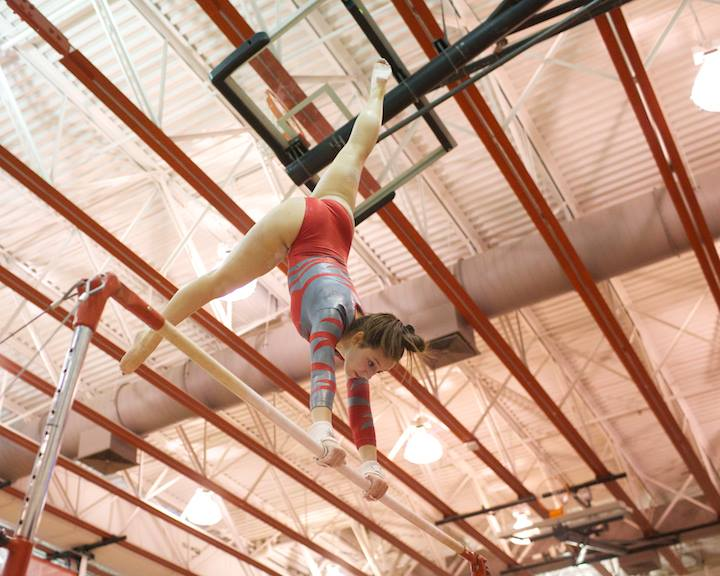McNastics+flip+to+success.+Sophomore+Tara+Stewert+performed+for+the+McNastics+on+the+uneven+bars.