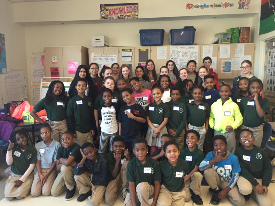 MHS+dance+team+and+accompanying+volunteers+pose+for+a+group+picture+with+the+kids+at+Stanton+Elementary+School+in+D.C..+