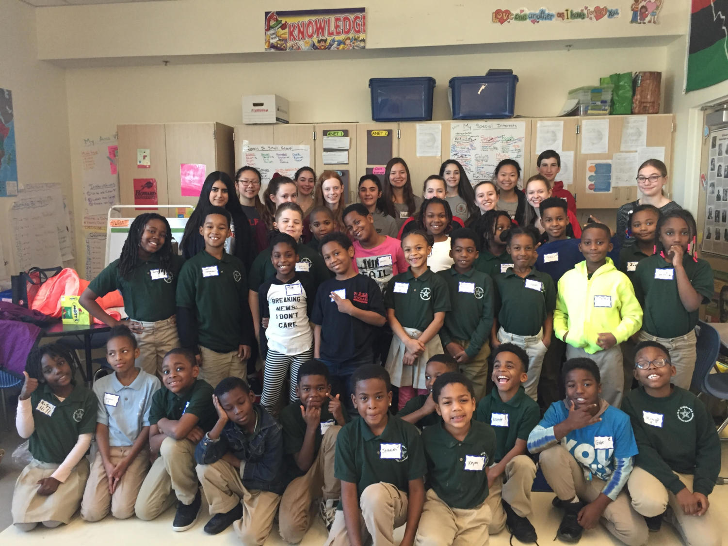 MHS dance team and accompanying volunteers pose for a group picture with the kids at Stanton Elementary School in D.C..
