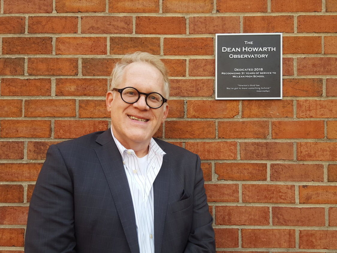 Physics teacher Dean Howarth smiles with the plaque dedicating the observatory in his name. This honor was given to Howarth as an acknowledgement of his 31-year career at McLean High School. (photo by Maren Kranking)