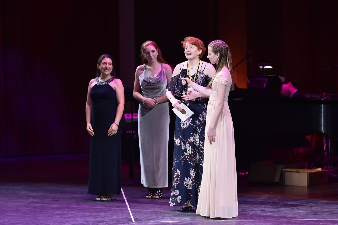 Abby Comey receiving award for best comedic actress, for her work in the musical 9-5.
