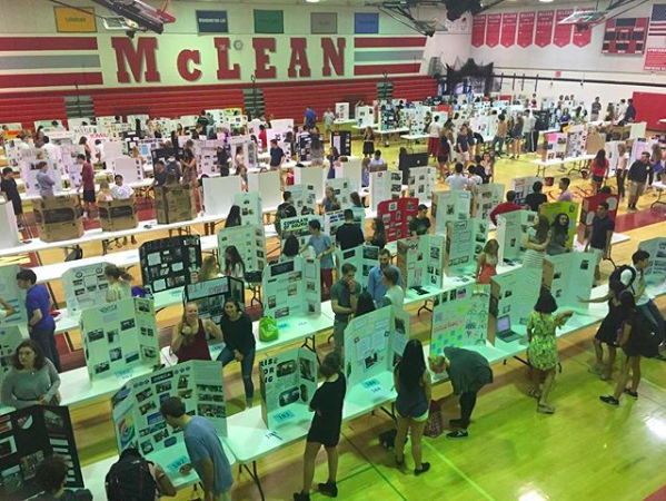 Board hoard - After interning at a range of locations for two weeks, over 200 seniors present their HIP projects on June 1 in the lower gym. (Photo courtesy of Greg Olcott)