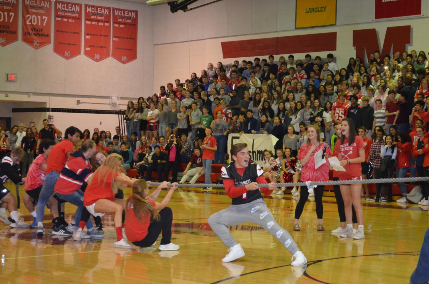 Senior Logan Johnson leads the student side of the student v. faculty game of tug-of-war