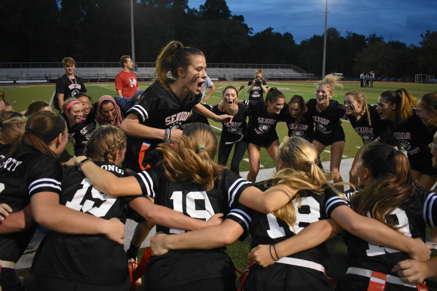 Senior JaneAnne Tvedt rallies her team during a time-out at the annual Powderpuff game on Oct. 10. The senior team won the match-up 8-0, marking the class' second win in a row. (photo by Maren Kranking)