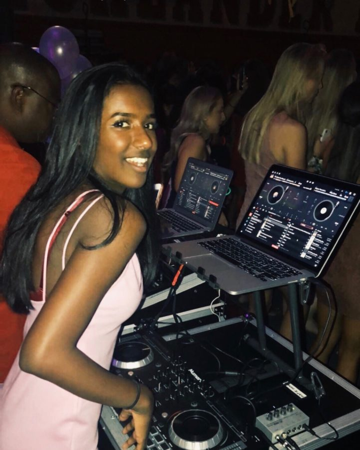 Sophomore+Maya+Nair+takes+over+and+helps+DJ+with+the+music.+Students+swarmed+the+dance+floor.+