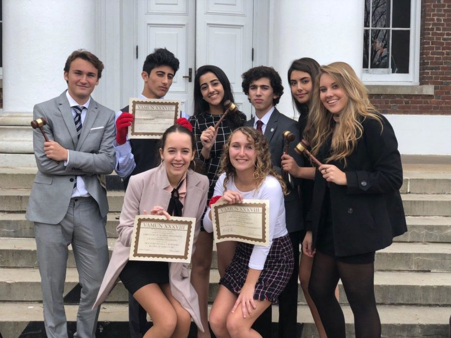 Seniors+of+the+McLean+Model+United+Nations+team+pose+with+awards+received+at+VAMUN+on+Nov.+18.+The+team+was+very+successful%2C+receiving+many+individual+awards+at+the+conference.+%28photo+courtesy+of+Maria+McHugo%29