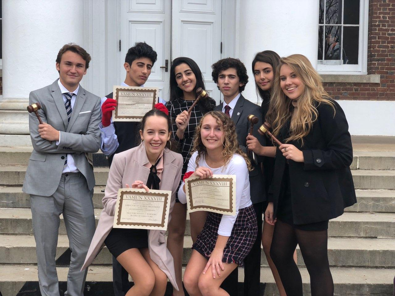Seniors of the McLean Model United Nations team pose with awards received at VAMUN on Nov. 18. The team was very successful, receiving many individual awards at the conference. (photo courtesy of Maria McHugo)
