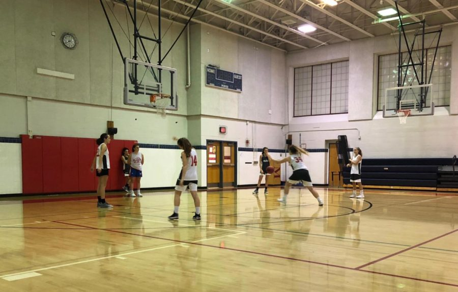 Girls+JV+basketball+team+works+hard+at+their+first+practice+of+the+season.+The+girls+are+excited+for+the+season