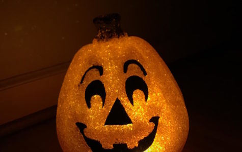 A lone Halloween pumpkin leers. Teens are often pressured to go to a party or stay home alone on Halloween night.