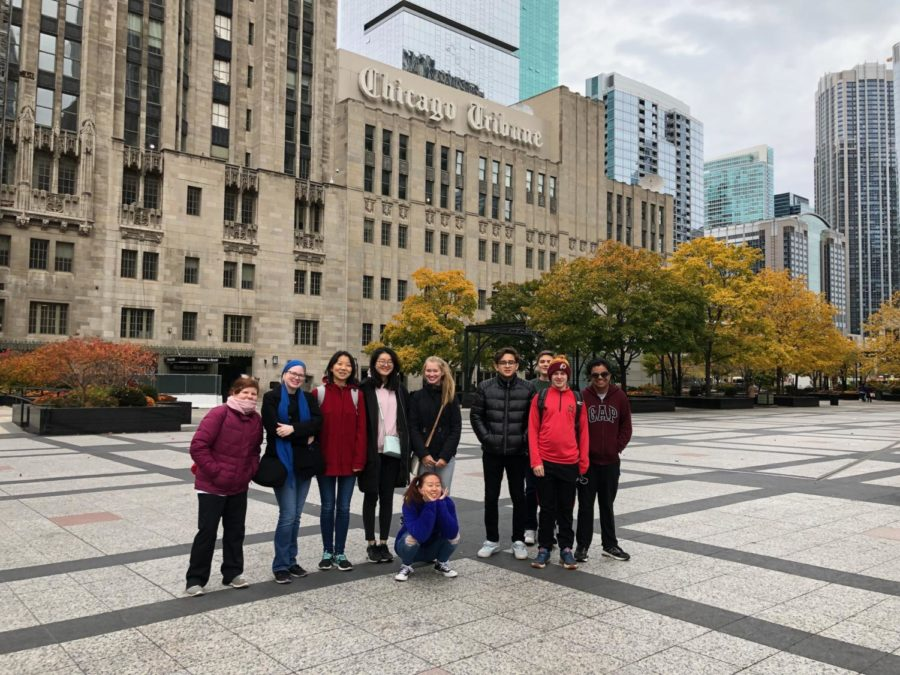 Journalism students smile for a group photo in front of the Chicago Tribune building.  The students enjoyed the tour around the city.