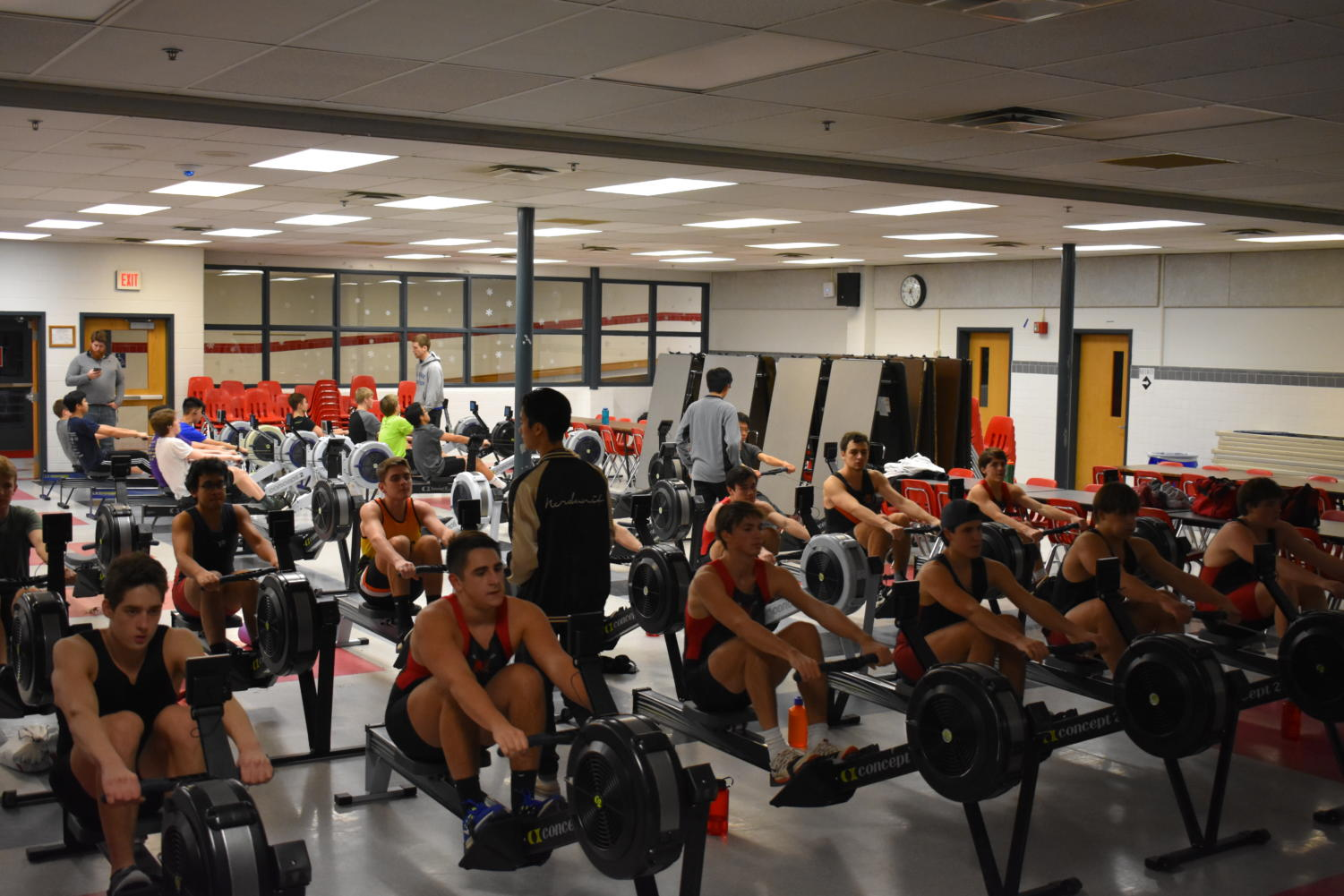 On a Monday afternoon, the McLean Men's Crew team brings the ergs into the cafeteria to perform pieces. Today, they are doing continuous rowing in 25 minute pieces to increase endurance.   Photo by Sebastian Jimenez
