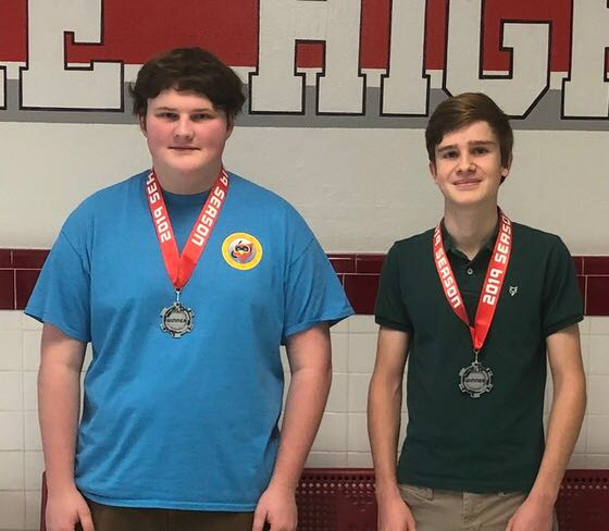 Seniors John Mutersbaugh (left) and Jules Le Menestrel (right) smile wearing their medals. The team stood out of more than 50 groups and received the