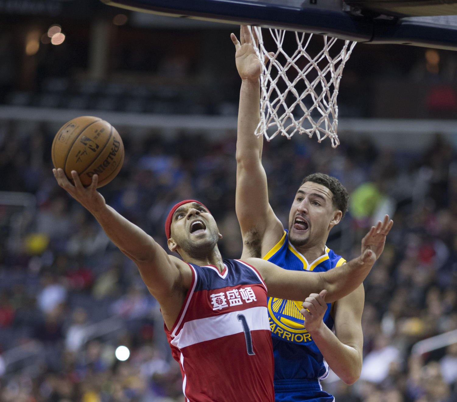Warriors shooting guard Klay Thompson contests Jared Dudley's layup at a game on 2/3/2016 Photo obtained via KeithAllisonPhoto.com on Flickr under a Creative Commons license