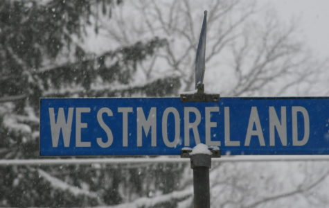 A street sign neighboring McLean endures the blizzard, effectively dispelling any question over school staying open.