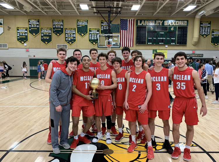 The McLean Highlanders men basketball team poses  at halfcourt following Rotary Cup win vs. Saxons. (Photo courtesy of Greg Miller).