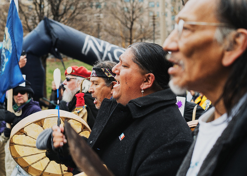Protesters gather at Washington DC, on Friday Jan. 18. Closets is Omaha Native Elder Nathan Phillips.