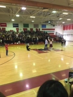 Teacher Tony Puzan gets pied in the face by our mascot Angus at the pep rally on Friday, Jan. 11. This was result of a money raising competition between teachers run by McDance-a-thon.