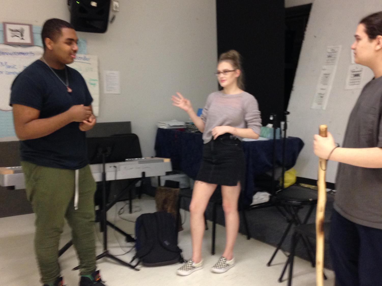 Practice Makes Perfect! Students practice the opening of We Are The Champions by Queen. The group is led by Nicholas Barrett and the other two students are sophomore Hollie Stephanie Dawnball and senior Nicholas Thomas.