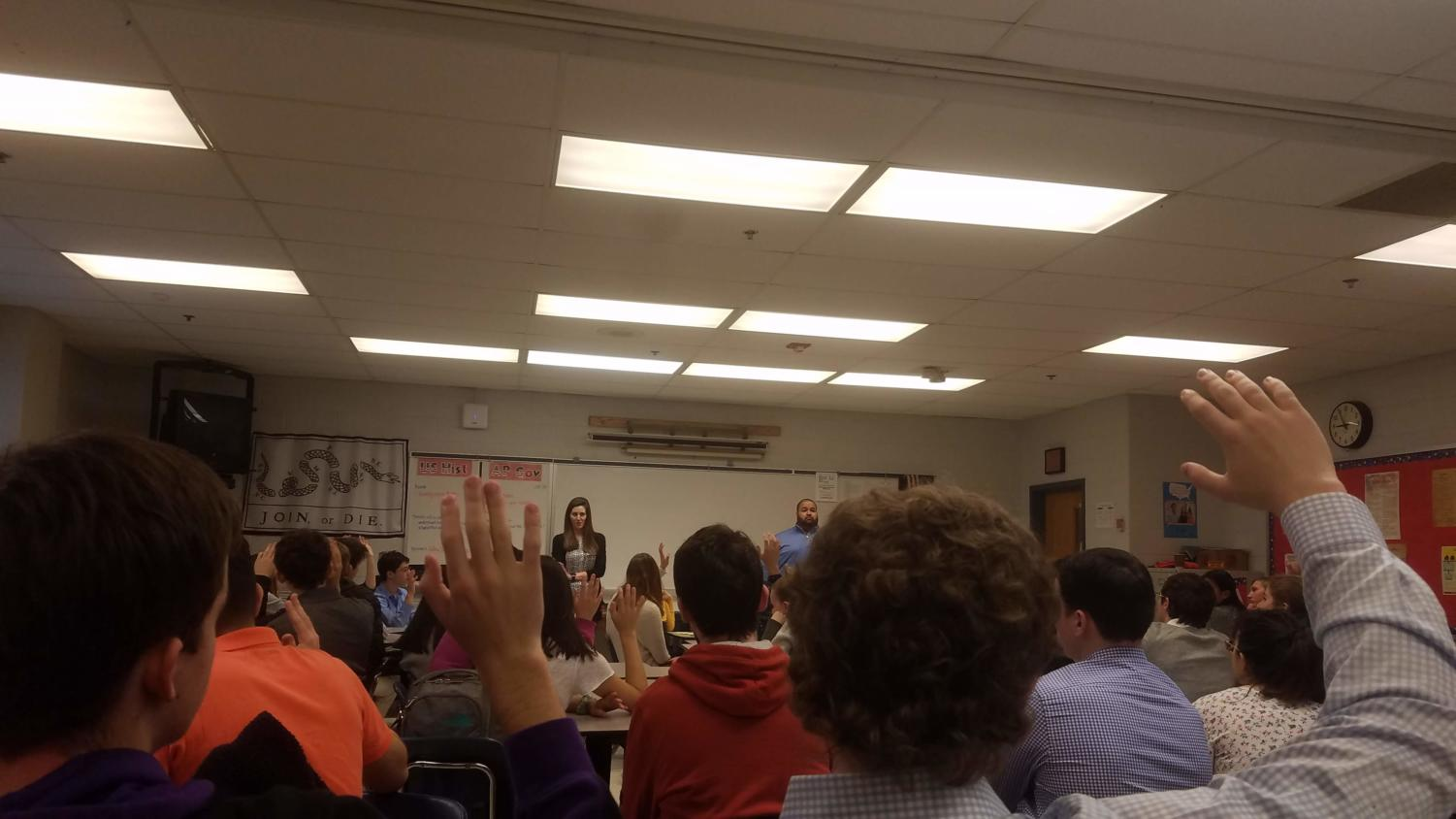 Hands go up as the regional admissions officers ask the juniors a question. This is during the first session of the