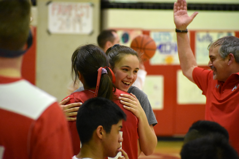 Polina+Leonova+receives+a+hug+from+one+of+the+referees+during+a+timeout.+%28photo+by+Maren+Kranking%29