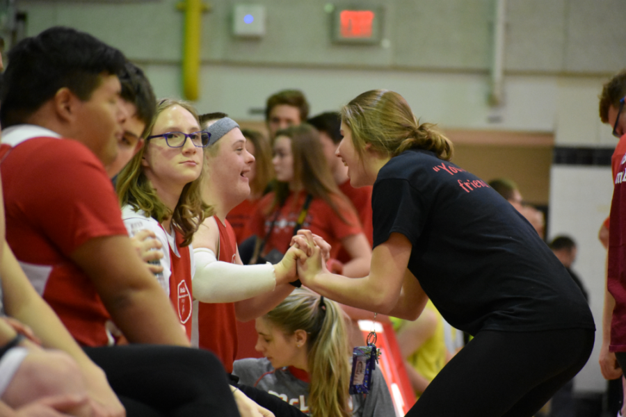 Junior+Maggie+Campion+encourages+Shue+and+the+rest+of+the+team+during+halftime.+%28photo+by+Maren+Kranking%29