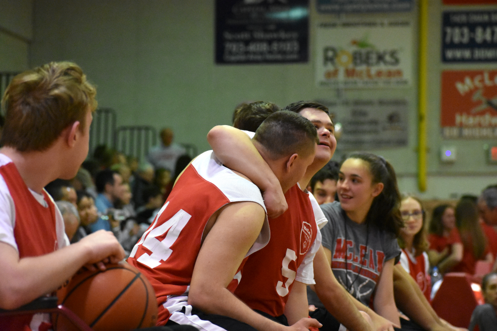 Peter+Conners+and+Bianco+put+their+arms+around+each+other+while+on+the+bench.+%28photo+by+Maren+Kranking%29