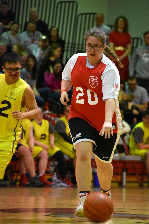 Marika+Bak+runs+the+ball+down+the+court+following+a+rebound.+%28photo+by+Maren+Kranking%29