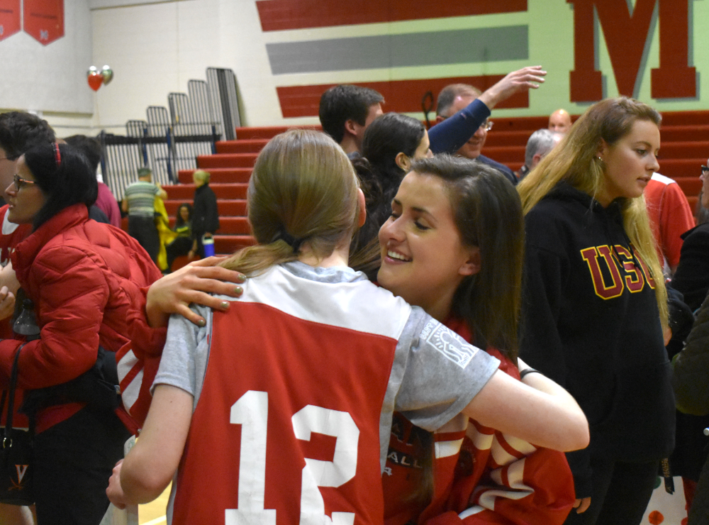 Criswell+hugs+senior+Sarah+Rice+following+the+game.+%28photo+by+Maren+Kranking%29