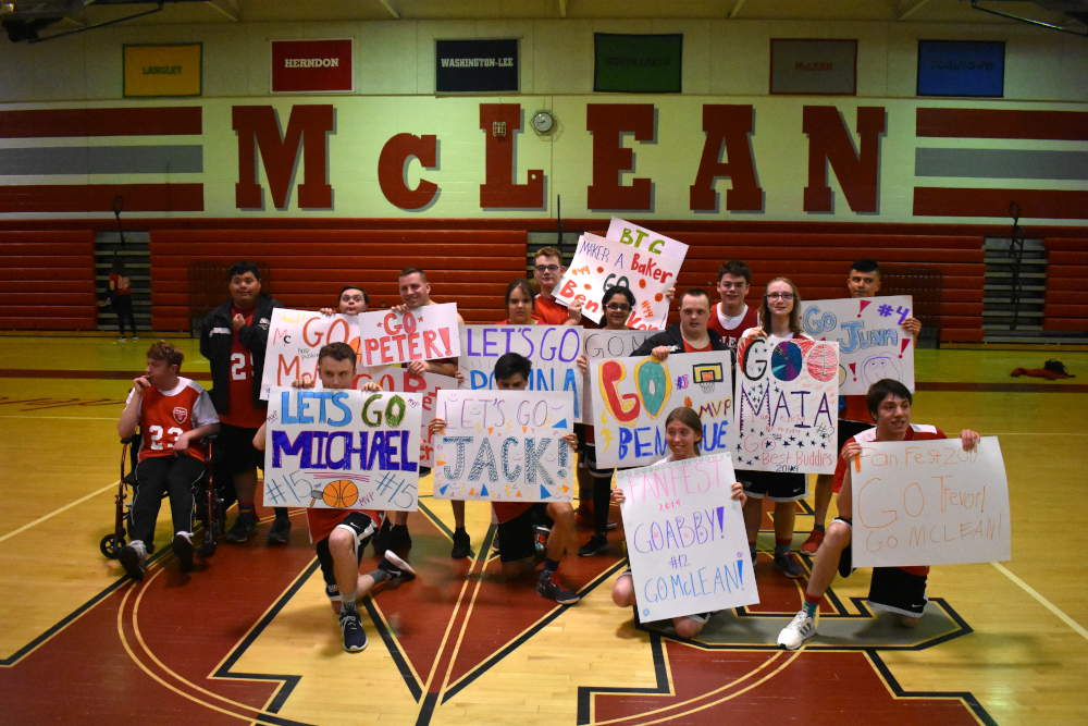 The+team+posed+for+parents+and+fans+with+signs+made+for+them.+%28photo+by+Maren+Kranking%29