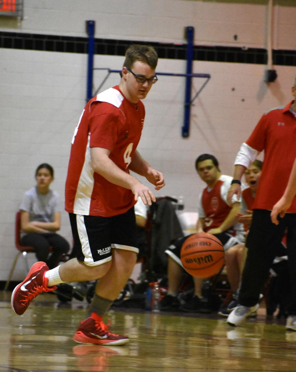 Ben+Baker+dribbles+the+ball+after+a+rebound.+%28photo+by+Maren+Kranking%29