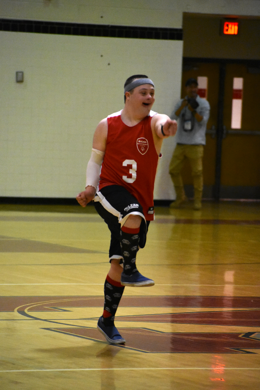 Following+a+3-point+shot%2C+Shue+celebrates+as+he+runs+back+down+the+court.+%28photo+by+Maren+Kranking%29