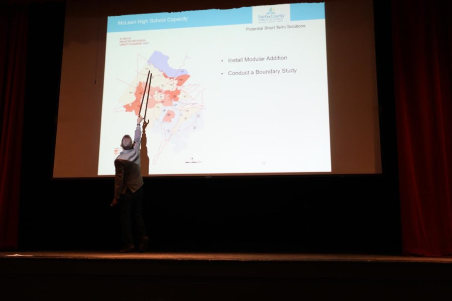 Kevin Sneed points to the current boundary map of Fairfax County. New adjustments are to be made in boundaries in upcoming years.