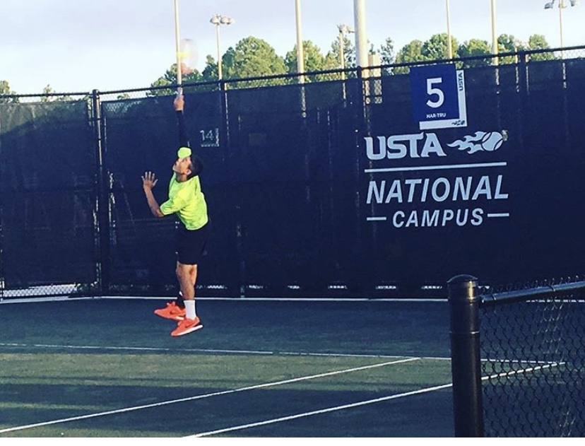 Nicholas+serves+the+ball+at+the+USTA+National+Campus.+He+has+been+playing+in+many+high-level+tournaments+in+order+to+get+recruited+by+top-tier+schools.+Photo+courtesy+of+Nathan+Nguyen