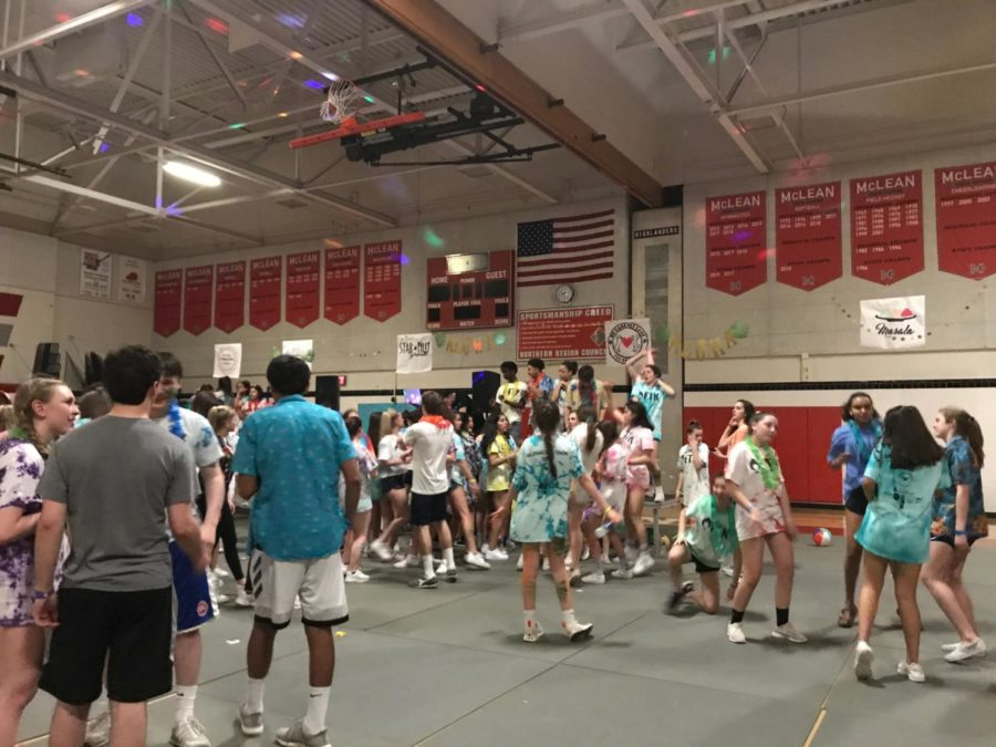 Leadership+students+and+their+peers+collect+on+the+McDance-a-thon+dance+floor+on+March+31.+The+dance+had+a+Hawaiian+theme.